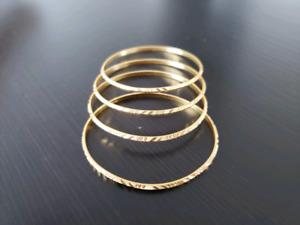 Four 22 Carat Gold Bracelets