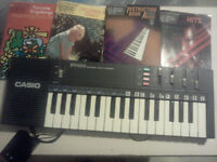 Casio keyboard with books for sale