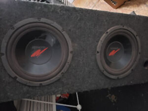 A set of 10 inch kenwood subwoofers in a sub box