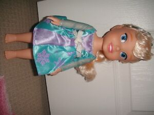 Elsa doll and Frozen books