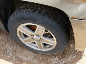 set of 4 215/65/17 like new winter tires on jeep patriot wheels