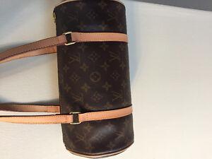 Louis Vuitton print leather bag