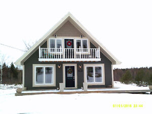 PRICE REDUCED on this Contemporary Chalet Home in Bethel, PEI