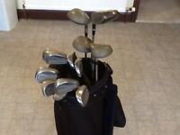 Golf clubs and golf bag.