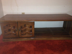 Solid wood coffee table with contained cabinet
