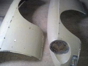 Front fibreglass fenders for MGB GT . Also rubber bumper .
