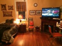 Income property with 2-3 bedroom, 2 studio apts,  rooms rented.