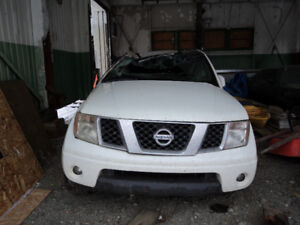 Rolled 2008 Nissan Frontier and 2002 Extera