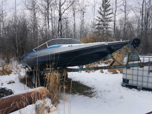 16ft fibreglass banchee boat,motor, and trailer