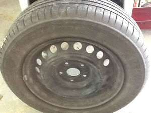 Michelin tires on rims and wheel cover for Camry