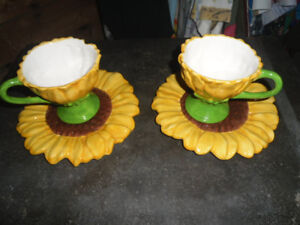 A SET OF 2 TELEFLORA SUNFLOWER CUP AND SAUCERS