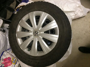 195/65R15 Conti Winters with VW rims and hubcaps