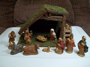 Vintage Manger With 11 Piece Nativity Set.