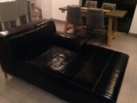 Black IKEA Faux leather sofa.