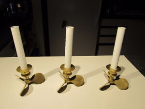 Set of 3 brass boat propeller themed candle holders.