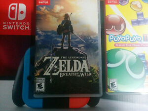 Nintendo Switch and 2 games.