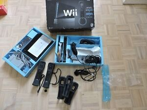 NINTENDO WII WITH 4 CONTROLLERS AND 3 NUNCHUCKS
