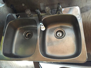 Kitchen sink with faucets