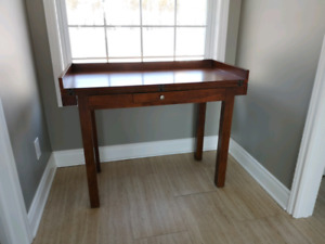 Wooden desk converts to table
