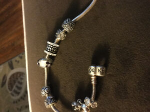Pandora bracelet and charms..will deliver
