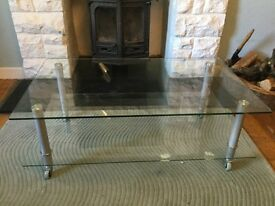 Glass TV table on castors
