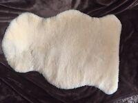 Baby sheepskin comforter rug