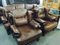 Brown leather 3 11 in an oak frame