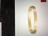 Lost gold bracelet with family initials inside it