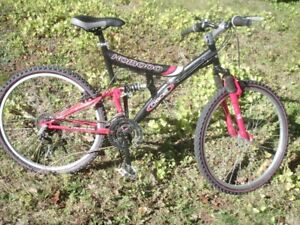 Komoco Cherokee 26 inch 21 speed /red and black
