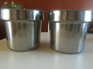 stainless steel insets for steam table in a commercial kitchen T