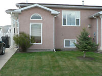 3 bdrm duplex; 1.5 bath, fenced yard, f/p, 5 appliances