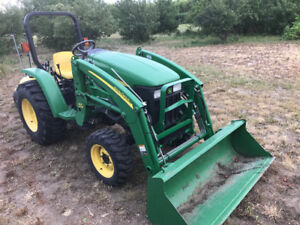 John Deere Acreage Tractor with attachments