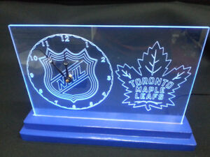 Toronto Maple Leafs LED clock on a Blue base.