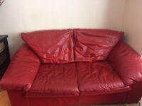 DFS leather two or three seater red sofa
