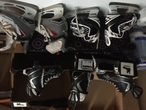 Multiple Pairs if Hockey Skates