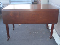 solid wood drop leaf dining table in exc cond