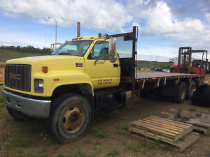 2002 GMC Flatbed truck with Moffet