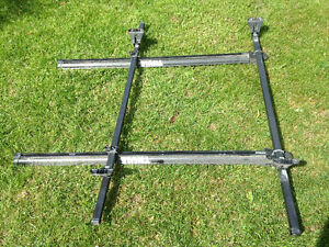 Thule roof-rack with dual bike channels and lock attachments ,