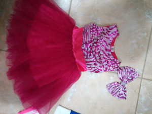 2 brand new Christmas dresses with matching bow