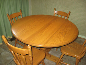 Solid Oak Pedestal Dining table and four chairs
