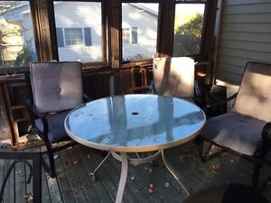 Glass table and 5 rocker padded chairs