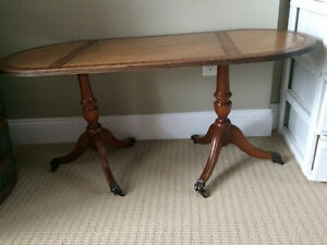Gorgeous unique double legs antique claw foot table with leather