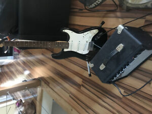 Child's electric guitar with amp