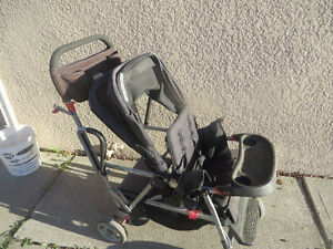 Black Joovy Caboose sit and stand stroller
