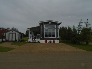 WOW!! MOVING!! AWESOME LOT WITH PARK MODEL AT TRESTLE CREEK