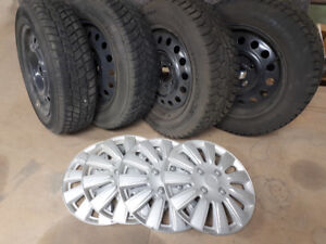 Winter tires with steel wheels and hubcaps for sale