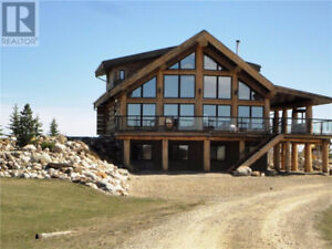 5.45 acre parcel set up for horses with custom built Log Home