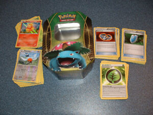 170 pokemon cards with a tin