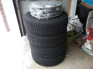 Firestone Winterforce snow tires 185/70/R14 w/ rims/hubs: $100