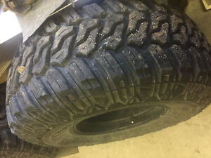 4 Mud Tires 35X12.5x15 on black alloy 6 bolt wheels plus spare